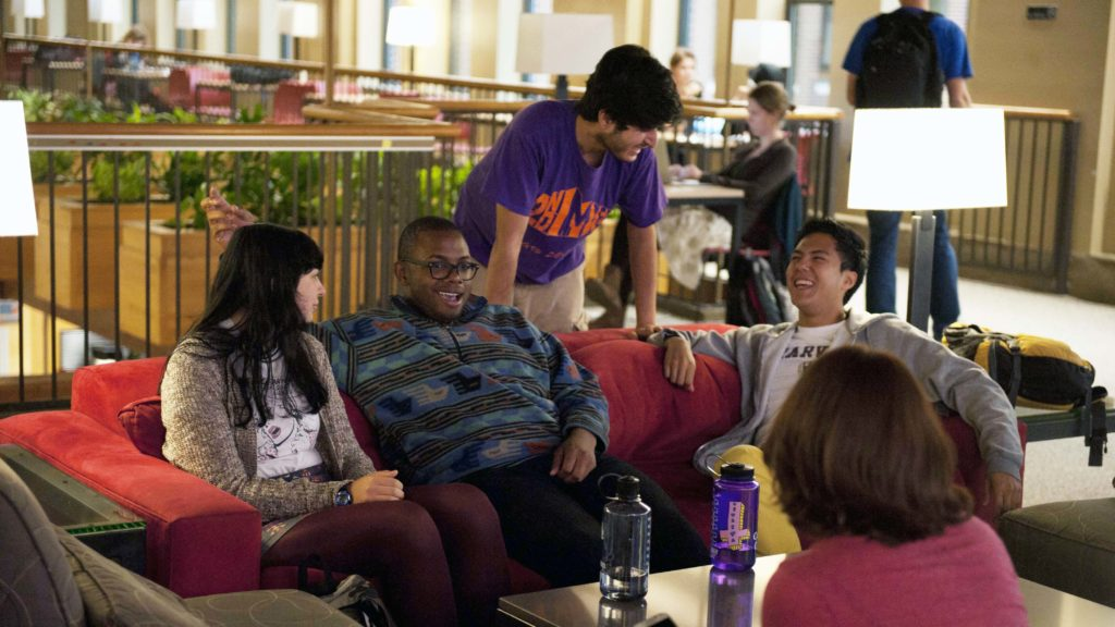 students hang out in the upper level of Sayles-Hill campus center