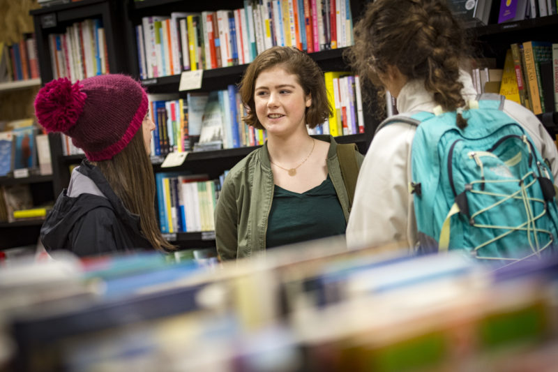Three people gather in a bookstore to talk about Carleton