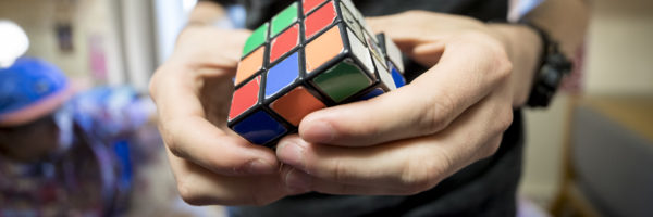 A student plays with a Rubik's Cube