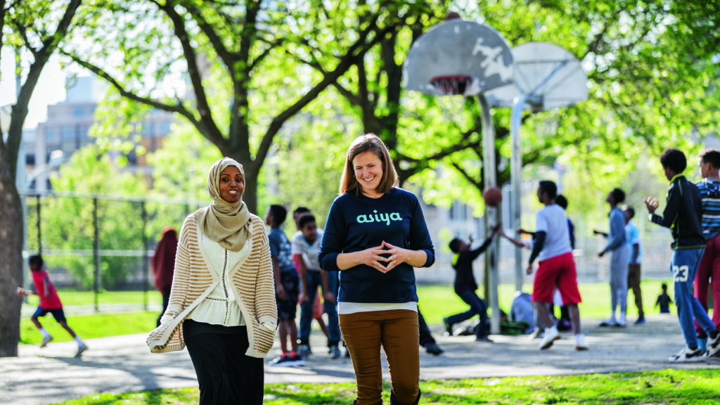 ASIYA Sport founders Fatimah Hussein and Jamie Glover '06 outside the Brian Coyle Community Center in Minneapolis