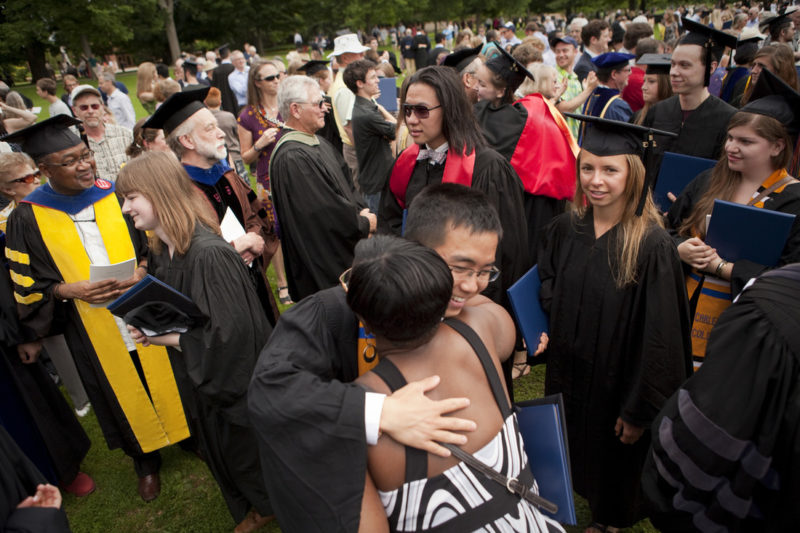 New grads hug Carleton faculty and staff after commencement
