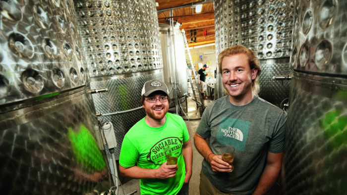 Sociable Cider Werks cofounders Wade Thompson '07 and Jim Watkins '07 in their brewery
