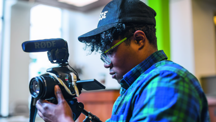 Filmmaker Brit Fryer '15 adjusts his video camera