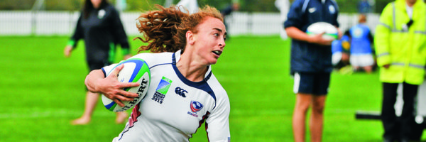 Ashley English running with a rugby ball