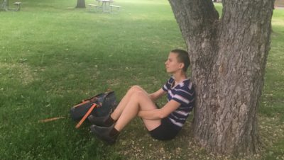 Sitting by a tree